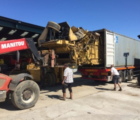 Combines are carefully dismantled before being loaded into containers for shipping. We are very experienced in loading 20Ft and 40ft High Cube containers.