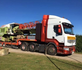 Combines & other large machines can be loaded onto a flat trailer to be transported abroad or to other parts of the country